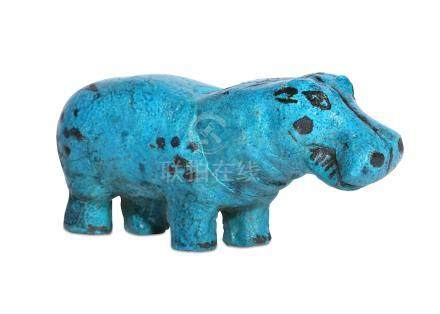 AN EGYPTIAN BRIGHT BLUE GLAZED HIPPOPOTAMUS Depicted with a large snout, bulging eyes, a plump