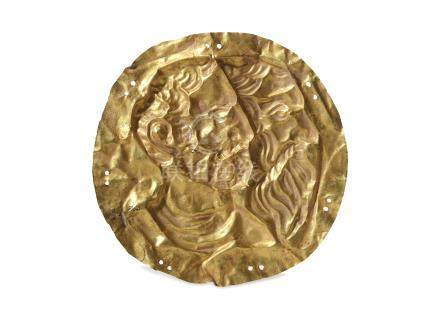 A SHEET GOLD APPLIQUE The applique is surrounded by several pairs of pierced circles allowing for