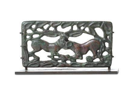 AN ORDOS BRONZE BELT BUCKLE Circa 2nd - 1st Century B.C. In the form of a feline grasping a doe by
