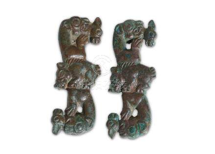 TWO ORDOS BRONZE GARMENT PLAQUES Ordos, Circa 5th - 4th Century B.C. Of S-shape with addorsed