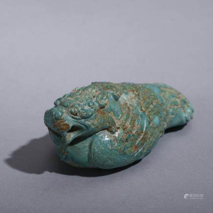 A CHINESE ARCHAIC TURQUOISE CARVED ORNAMENT