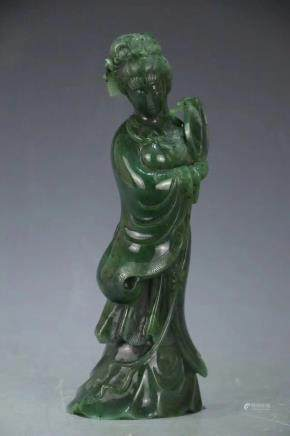 A GREEN JADE FIGURE OF STANDING LADY