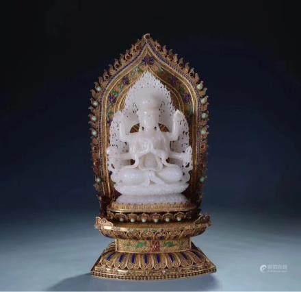 A JADE FIGURE OF SEATED BODHISATTVA