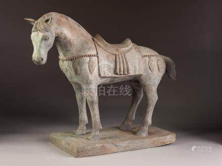 AN INTERESTING CHINESE TANG DYNASTY STYLE CAST BRONZE SADDLED HORSE, ON A RECTANGULAR PLINTH BASE,