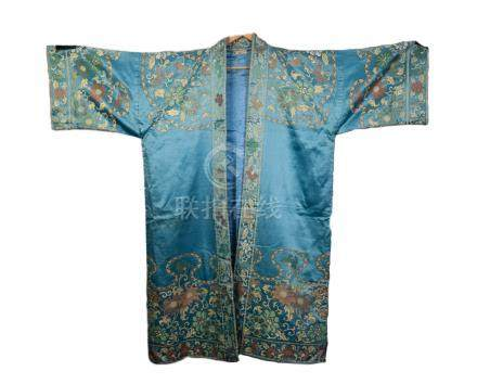 A CHINESE EMBROIDERED SILK COVERLETTE worked in colourful silks with predominately pink flowers on a