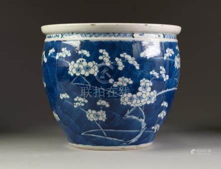 NINETEENTH CENTURY CHINESE BLUE AND WHITE PORCELAIN JARDINIÈRE, of typical form, painted with prunus