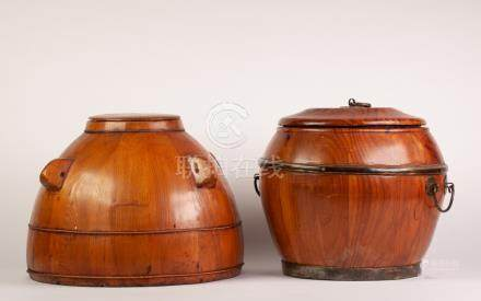 TWO CHINESE PINE WOOD RICE CONTAINERS AND COVERS, one brass mounted and with two handles, the