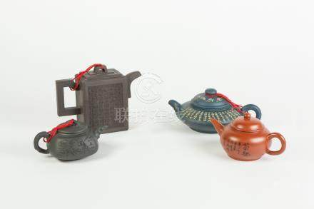 FOUR CHINESE YIXING STONE CHINA TEAPOTS, in varying colour clays, also an INDIAN CARVED IVORY