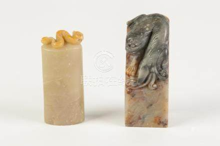 A CHINESE LIGHT BROWN SOAPSTONE SEAL of oval section carved with a surmounting mythical beast, 2 1/