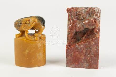 "A CHINESE SOAPSTONE SQUARE SEAL, carved with a chilong, 2 1/2"" (6.5cm) high, AND ANOTHER of"