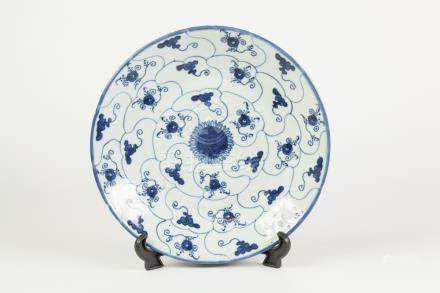 A CHINESE CHING DYNASTY SHALLOW DISH, painted autour in underglaze blue with compartmental ruyi