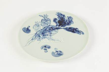 A TWENTIETH CENTURY CHINESE PORCELAIN SMALL PLATE, painted in underglaze blue with root vegetables