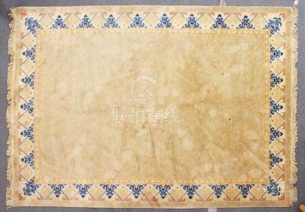 A CHINESE CARPET, beige ground, with a border decorated with a stylised design. 11ft 8ins x 8ft