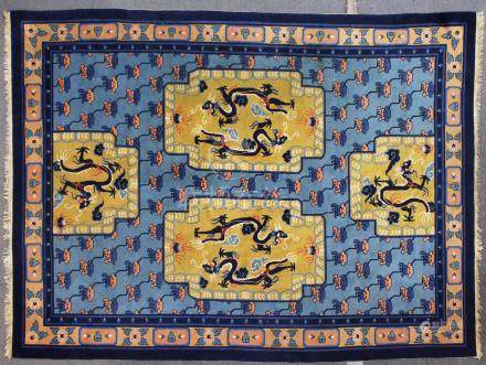 A GOOD CHINESE CARPET, pale blue ground with four panels, decorated with dragons chasing the
