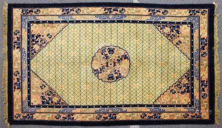 A CHINESE CARPET, beige ground, with trellis work and floral ground panel and central floral