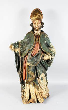 A LARGE 17TH-18TH CENTURY ITALIAN CARVED WOOD AND PAINTED STANDING FIGURE OF A CARDINAL. 42ins