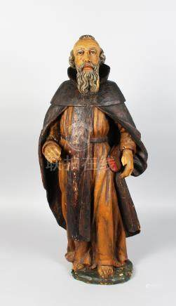 AN 18TH CENTURY CARVED WOOD AND PAINTED FIGURE OF A MAN holding a bible. 30ins high.