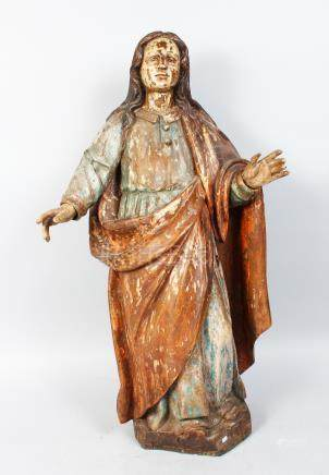 A 17TH-18TH CENTURY ITALIAN CARVED WOOD AND PAINTED FIGURES, arms outstretched. 28ins high.