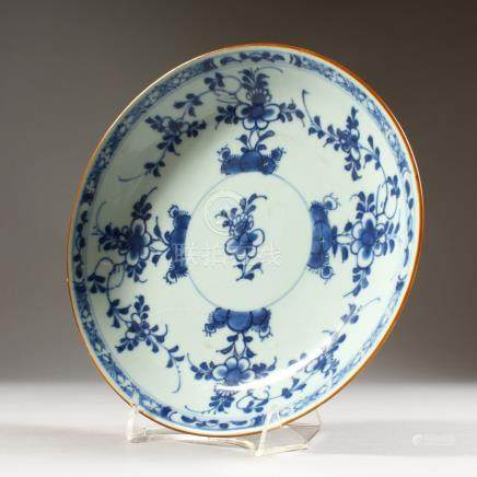 A CHINESE BLUE AND WHITE PAINTED CIRCULAR DISH. 9ins diameter.