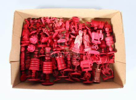 A COLLECTION OF SIXTY CHINESE CARVED RED CHESS PIECES. Largest 9cms.