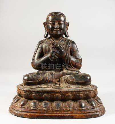 A BRONZE SEATED BUDDHA, QING DYNASTY, seated on a double lotus throne and wearing a voluminous robe,
