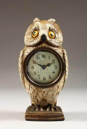 AN AUSTRIAN PAINTED METAL OWL CLOCK. 7ins high.