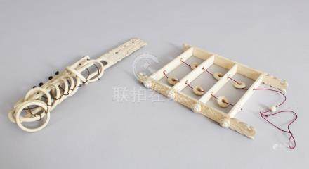 TWO CARVED IVORY CHINESE GAMES.