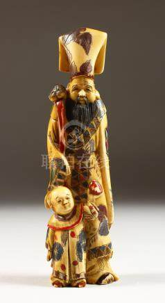 A CHINESE CARVED AND STAINED IVORY FIGURE OF A MAN WITH A BOY. 7ins high.
