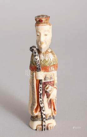 A CHINESE CARVED AND STAINED IVORY FIGURE SNUFF BOTTLE. 4ins high.