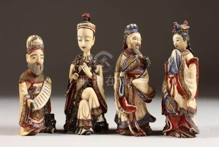 "A SET OF FOUR CHINESE CARVED AND STAINED IVORY FIGURES ""SNUFF BOTTLES"". 4ins high."