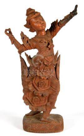 A SOUTH EAST ASIAN CARVED HARDWOOD FIGURE OF A GUARDIAN, 63CM H