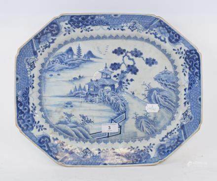 A Chinese porcelain plate, decorated a landscape in underglaze blue, 41.5 cm wide