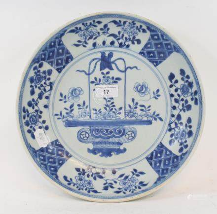 A Chinese porcelain bowl, decorated flowers in a basket in underglaze blue, 30 cm diameter