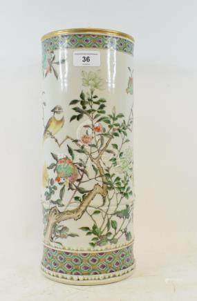 A Chinese porcelain cylindrical vase, decorated a bird perched on a flowering tree, cracked, 36.5 cm