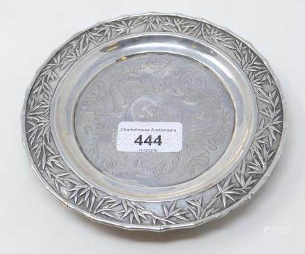 A Chinese silver coloured metal tray, monogrammed, engraved dragons, within a bamboo border, stamped