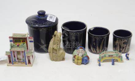 A blue pottery jar and cover, with three graduated measures, 10 cm high, a Chinese shrine, a similar
