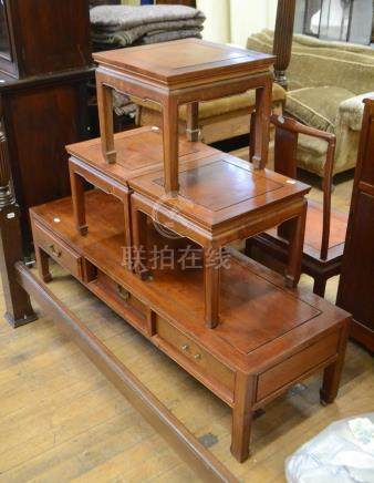 A set of three Chinese hardwood occasional tables, 46 cm wide, a similar low table, with drawers,