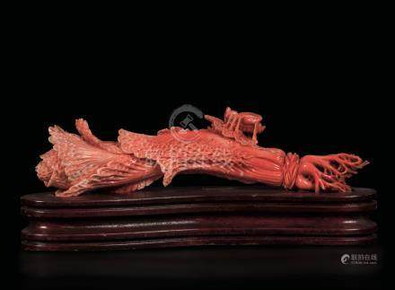 A carved coral group depicting a vegetable and a bug, China, early 20th century