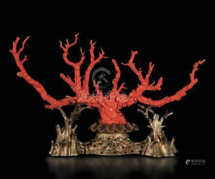 A large carved coral branch with everyday life scenes mounted on a gilt silver base with sapphire inlays, designed and manufactured by Angelo Giorgio Cazzaniga (1955 ca), China, 19th century