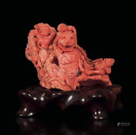 A carved coral group depicting monkeys and a wolf, China, early 20th century