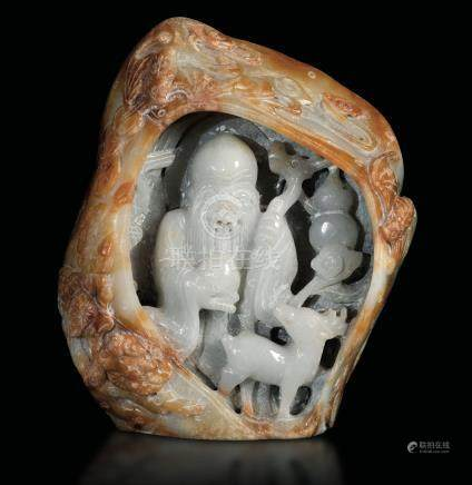 A carved jadeite group, China, 1900s