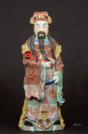 A figure of a dignitary with ruyi in polychrome porcelain, China, Qing Dynasty, 19th century