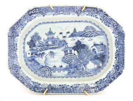 A Chinese blue and white rectangular platter,18th century, painted with a watery landscape with a