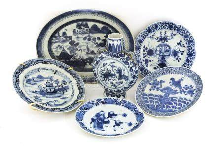 A group of Chinese blue and white porcelain:a charger,19th century, painted with a watery