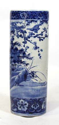 A Chinese blue & white cylindrical stick stand decorated with birds and foliage, 62cms (24.5ins)