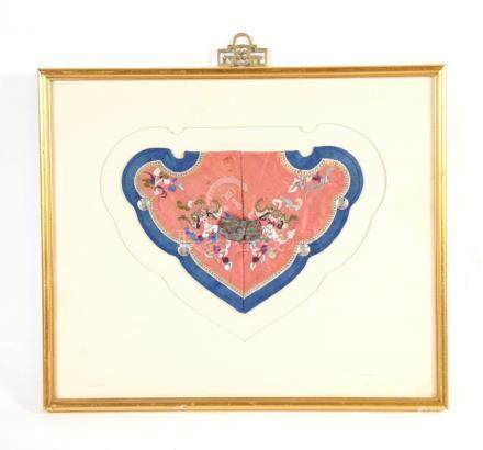 A Chinese silk embroidered collar decorated with bats and flowers, mounted in a frame, 25cms (9.