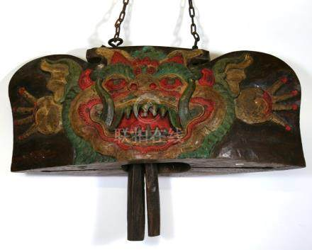 A large Asian carved & painted hardwood bell, 84cms (39ins) wide.