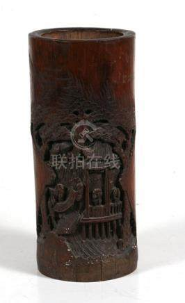 A Chinese bamboo brush pot carved with figures within a landscape, 29cms (11.5ins) high.