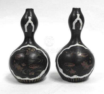 A pair of 19th century Chinese double gourd vases with gilt decoration on a black ground, 18cms (