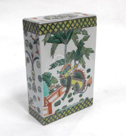 A Chinese famille rose flower brick or pillow decorated with a dragon and a lion, 19.5cms (7.